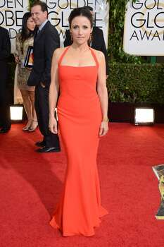 Julia Louis-Dreyfus arrives at the 71st annual Golden Globe Awards at the Beverly Hilton Hotel on Sunday, Jan. 12, 2014, in Beverly Hills, Calif. ( Photo: Jordan Strauss, Associated Press