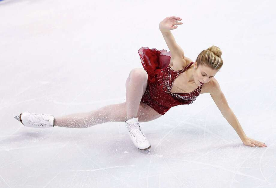 Ashley Wagner tumbled to a fourth-place finish Saturday night but still ended up as one of the three skaters who will represent the U.S. at the Sochi Games. Photo: Jared Wickerham, Staff / 2014 Getty Images
