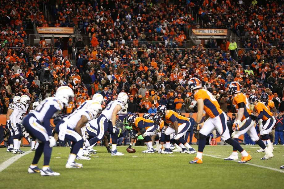 Division Round Jan. 12: Broncos 24, Chargers 17  The Chargers line up against the Broncos. Photo: Christian Petersen, Getty Images