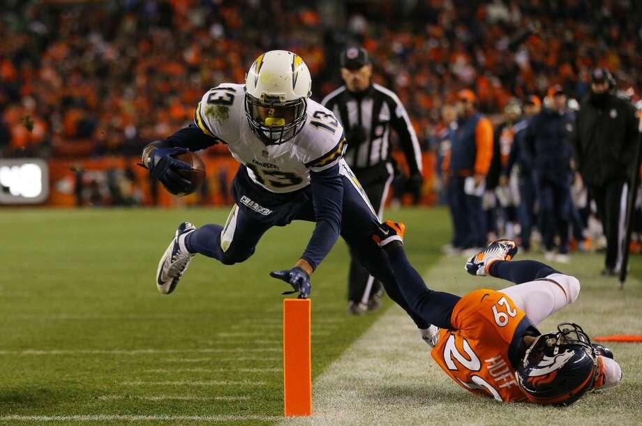 Keenan Allen #13 scores a fourth quarter touchdown against  Michael Huff #29. Photo: Justin Edmonds, Getty Images