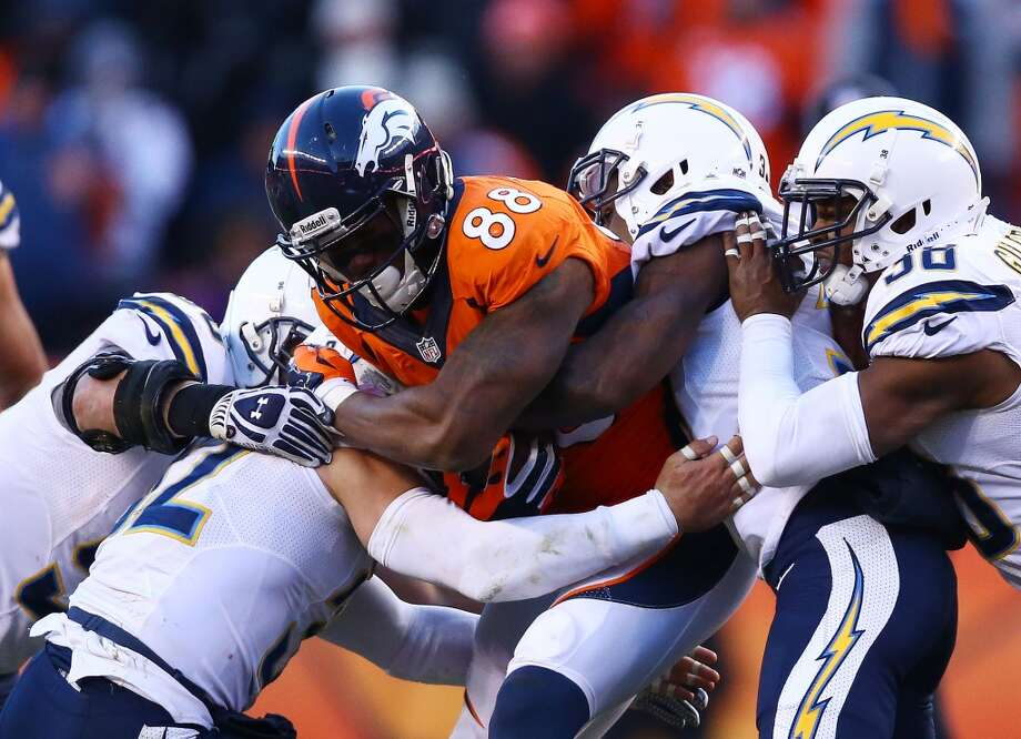 Demaryius Thomas #88 of the Broncos pushes through tacklers for a first down. Photo: Doug Pensinger, Getty Images