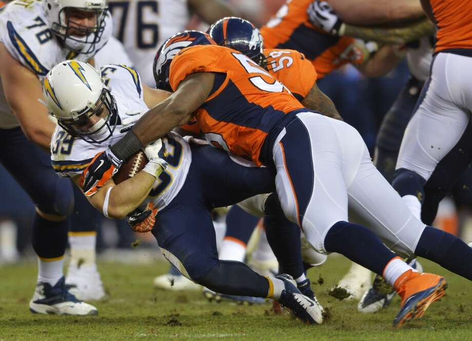 Chargers running back Danny Woodhead (39) is tackled by Broncos outside linebacker Nate Irving (56). Photo: Jack Dempsey, Associated Press