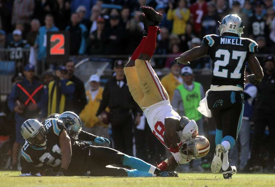 Anquan Boldin is flipped by Mike Mitchell. Photo: Ben Earp, Associated Press