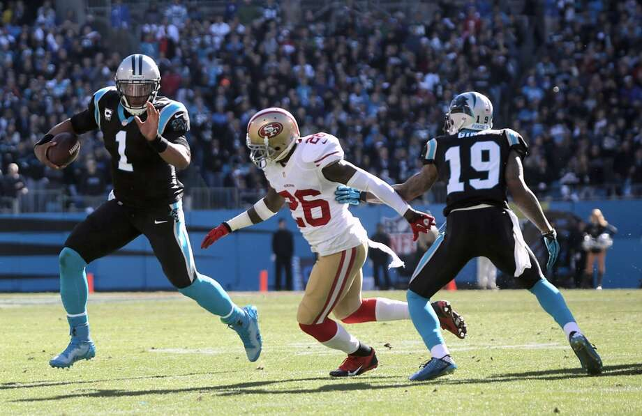 quarterback Cam Newton (1) runs the ball around the Tramaine Brock (26). Photo: Ben Earp, Associated Press