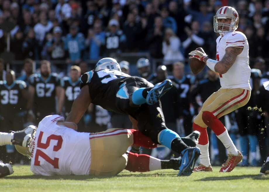 49ers Colin Kaepernick, right, looks to pass. Photo: Ben Earp, Associated Press