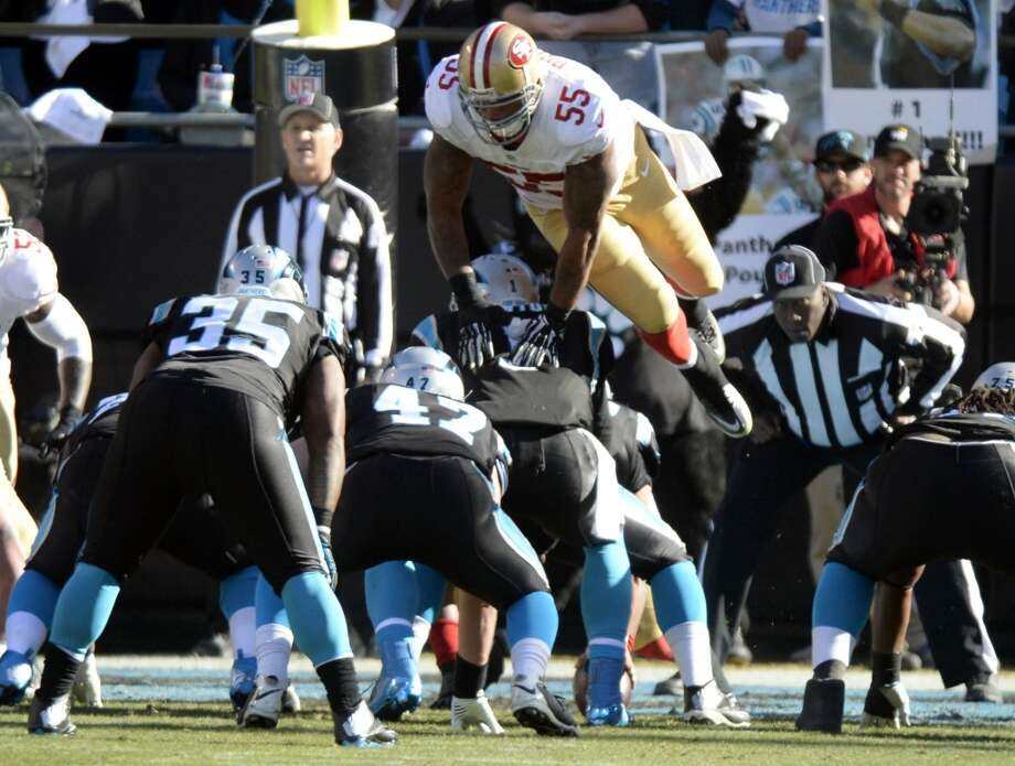 Ahmad Brooks (55) touches Cam Newton (1) as he jumps off sides. Photo: David T. Foster III, McClatchy-Tribune News Service