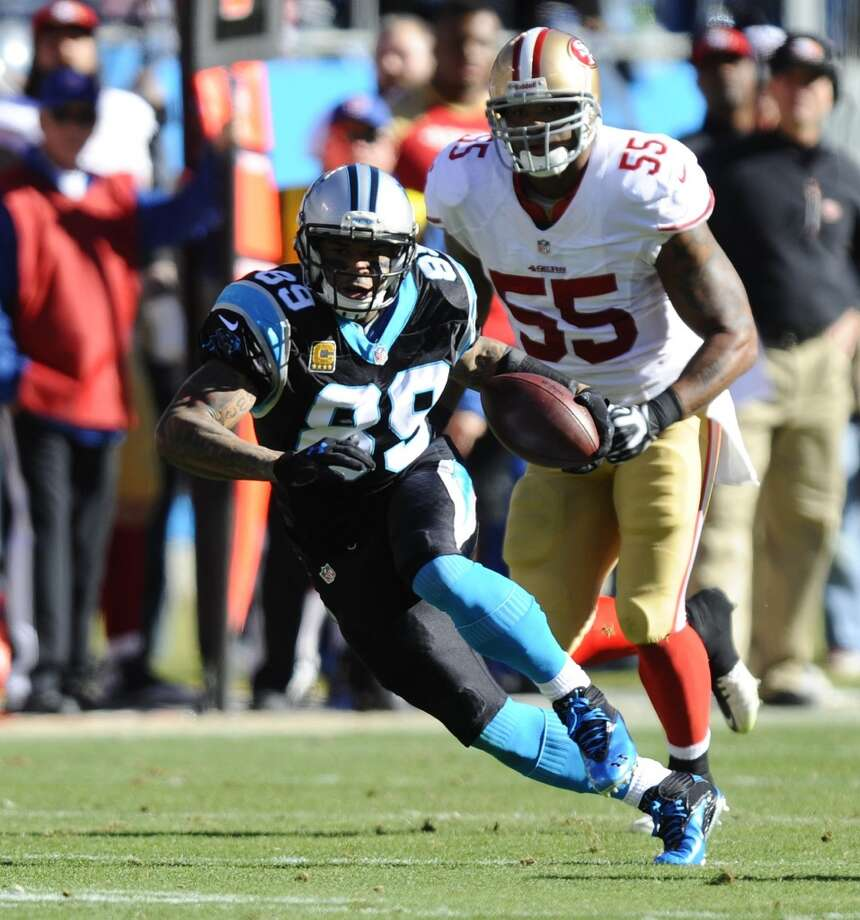 Steve Smith (89) heads up field past Ahmad Brooks (55). Photo: David T. Foster III, McClatchy-Tribune News Service