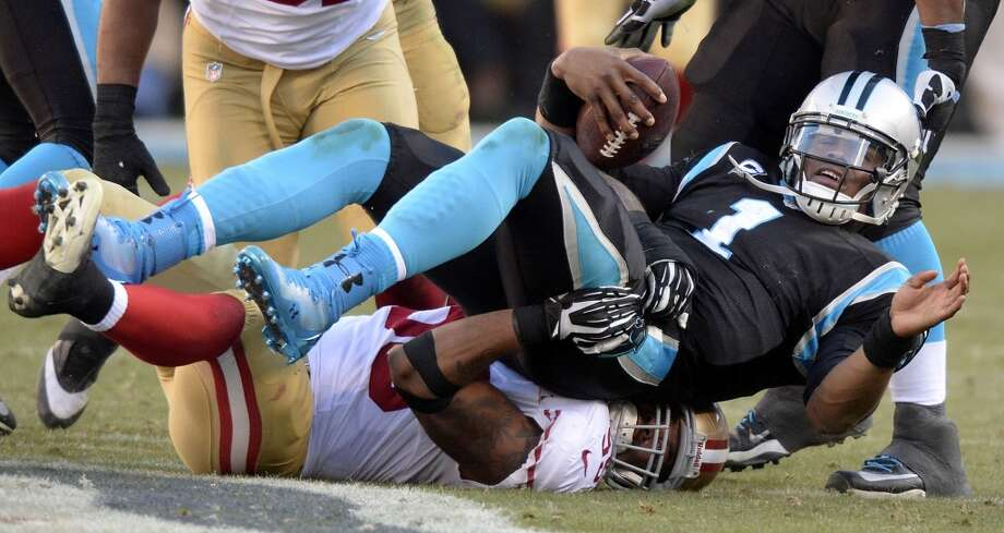 Cam Newton (1) is sacked by Ahmad Brooks (55). Photo: David T. Foster III, McClatchy-Tribune News Service