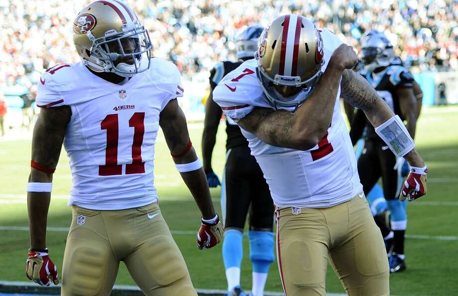 Colin Kaepernick (7), right, celebrates scoring a touchdown. Photo: David T. Foster III, McClatchy-Tribune News Service