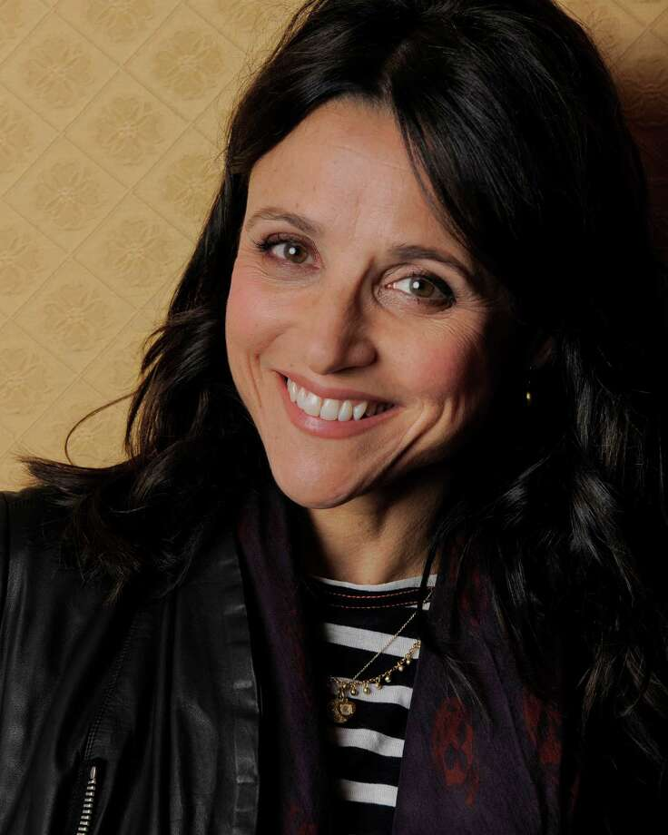 """Julia Louis-Dreyfus, a cast member in the film """"Enough Said,"""" poses for a portrait on day 4 of the 2013 Toronto International Film Festival on Sunday, Sept. 8, 2013 in Toronto. From """"Seinfeld"""" to """"Veep,"""" Louis-Dreyfus has been perhaps the finest comedic actress of her generation, she has stuck largely to the small screen """"much to my agent's chagrin,"""" she says.  (Photo by Chris Pizzello/Invision/AP) ORG XMIT: TOCP306 Photo: Chris Pizzello / Invision"""