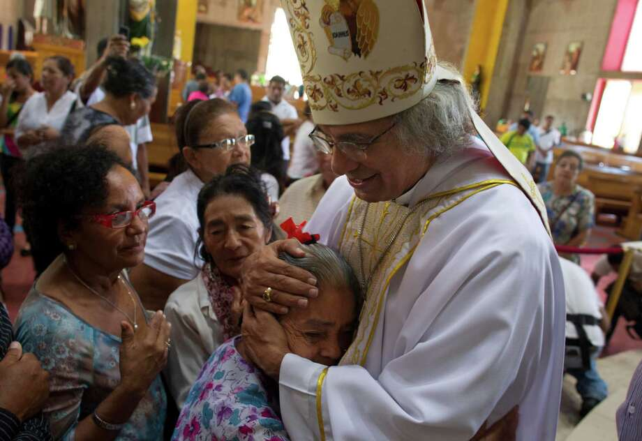 Newly named cardinal, Archbishop of Managua Leopoldo Jose Brenes embraces a woman as he is congratulated at the end of a Mass at the Metropolitan Cathedral in Managua, Nicaragua. Pope Francis named his first batch of cardinals on Sunday, choosing 19 men from around the globe that include Nicaragua, Argentina, Chile, Haiti and Brazil. Photo: Esteban Felix, STF / AP