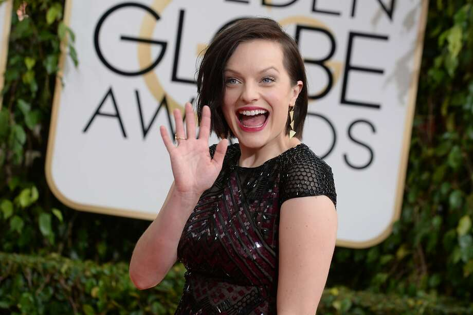 Worst: Elisabeth Moss. Holy smoke, lady, what are you wearing, the Chrysler Building? Photo: Jordan Strauss, Associated Press