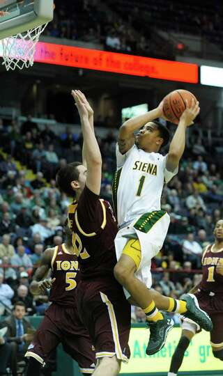 Siena's Marquis Wright drives to the basket during the Siena Iona men's basketball game on Sunday, J