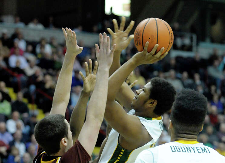Siena's Lavon Long puts up a shot over Iona defenders during the Siena Iona men's basketball game on