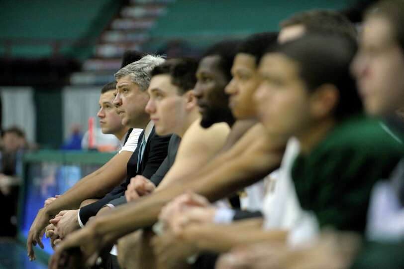 Siena head coach Jimmy Patsos, second from left, watches his players on the floor during the Siena I