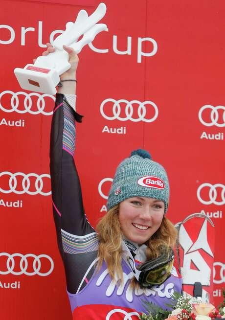Mikaela Shiffrin, of the United States, celebrates on podium after winning an alpine ski, women's World Cup slalom, in Bormio, Italy, Sunday, Jan. 5, 2013. (AP Photo/Marco Trovati) Photo: Marco Trovati, STR / AP