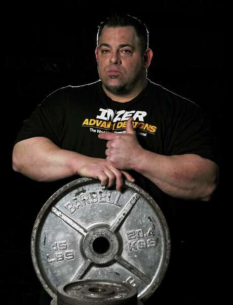 Monster Gym's Tiny Meeker, who recently became the first man in the world to bench press over 1,100 pounds, poses for a portrait on Sunday in Kingwood. Photo: James Nielsen, Staff / © 2013  Houston Chronicle