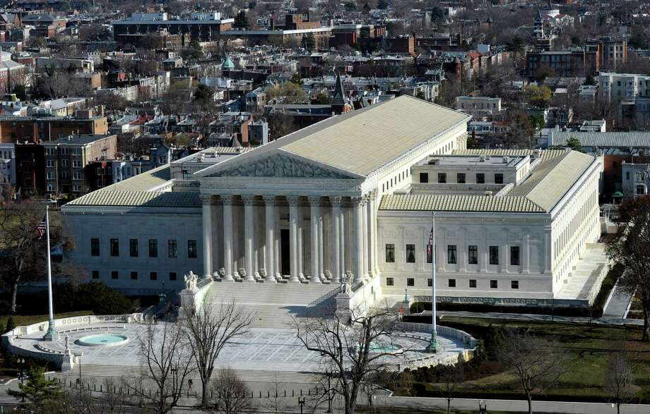 FILE - In this Dec. 19, 2013 file photo, a view of the Supreme Court can be seen from the view from near the top of the Capitol Dome on Capitol Hill in Washington. The Supreme Court hears arguments Monday in a clash between President Obama and Senate Republicans over the power granted the president in the Constitution to make temporary appointments to fill high-level positions.   (AP Photo/Susan Walsh) Photo: Susan Walsh, STF / AP
