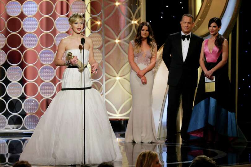 This image released by NBC shows Jennifer Lawrence, left, accepting the award for best supporting ac