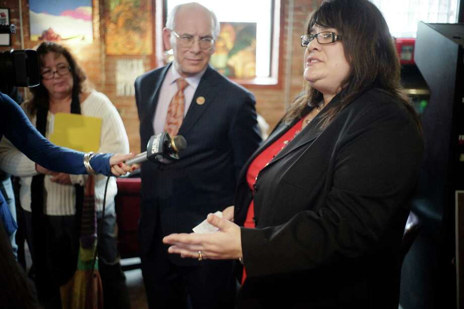 Lisa Cicchinelli, foreground, of Loudonville, talks about the struggles of unemployment as Congressman Paul Tonko, center, and Laurie Curthoys, of East Greenbush, look on  during a meeting at the Hudson River Coffee House on Sunday, Jan. 12, 2014 in Albany, NY.  Cicchinelli and Curthoys, who is also unemployed, meet with Congressman Tonko and Assembly member Pat Fahy to discuss the need to help the unemployed who have lost their unemployment insurance.   (Paul Buckowski / Times Union) Photo: Paul Buckowski / 00025280A