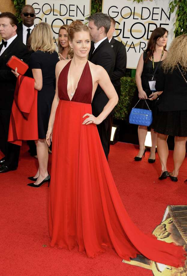 """Amy Adams (""""American Hustle"""") loves rainbow-bright hues, as evidenced by the triumphant two-tone shades-of-red Valentino number she wore to the Golden Globes in January. Photo: Jason Merritt, Getty Images / 2014 Getty Images"""