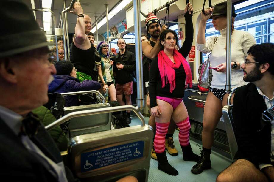 Proud participants shed their trousers for the fifth annual No Pants Light Rail Ride Sunday, Jan. 12, 2014, from Seattle to SeaTac. Presented by Emerald City Improv, the event brought hundreds to ride the Central Link light rail, pretending nothing was different about their bottomless wardrobes than any other day of the year. Photo: JORDAN STEAD, SEATTLEPI.COM / SEATTLEPI.COM
