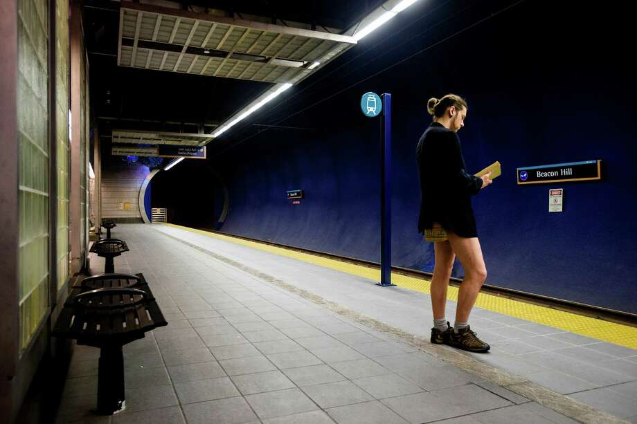 A trouser-free participant awaits a train at the fifth annual No Pants Light Rail Ride Sunday, Jan. 12, 2014, from Seattle to SeaTac. Presented by Emerald City Improv, the event brought hundreds to ride the Central Link light rail, pretending nothing was different about their bottomless wardrobes than any other day of the year. Photo: JORDAN STEAD, SEATTLEPI.COM / SEATTLEPI.COM