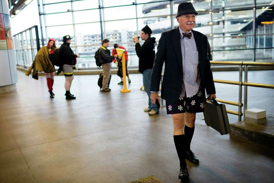 Proud participants meander the airport during the fifth annual No Pants Light Rail Ride Sunday, Jan. 12, 2014, from Seattle to SeaTac. Presented by Emerald City Improv, the event brought hundreds to ride the Central Link light rail, pretending nothing was different about their bottomless wardrobes than any other day of the year. Photo: JORDAN STEAD, SEATTLEPI.COM / SEATTLEPI.COM
