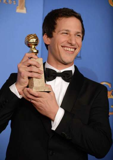 Andy Samberg poses in the press room with the award for best actor in a television series - comedy o