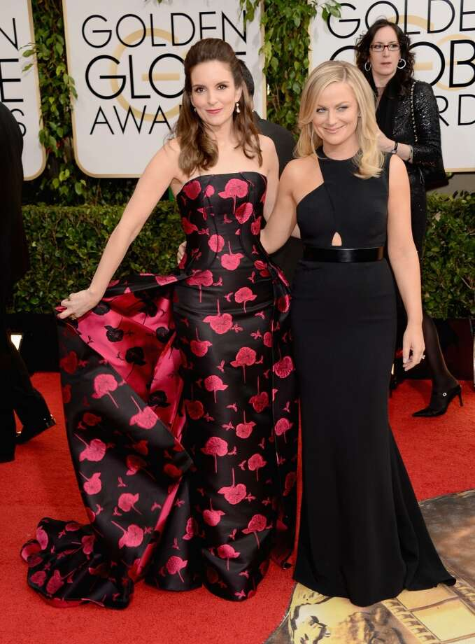 Actresses Tina Fey (L) and Amy Poehler attend the 71st Annual Golden Globe Awards held at The Beverly Hilton Hotel on January 12, 2014 in Beverly Hills, California. Photo: Jason Merritt, Getty Images
