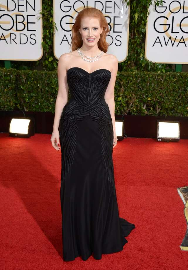 Jessica Chastain arrives at the 71st annual Golden Globe Awards at the Beverly Hilton Hotel on Sunday, Jan. 12, 2014, in Beverly Hills, Calif. Photo: Jordan Strauss, Associated Press