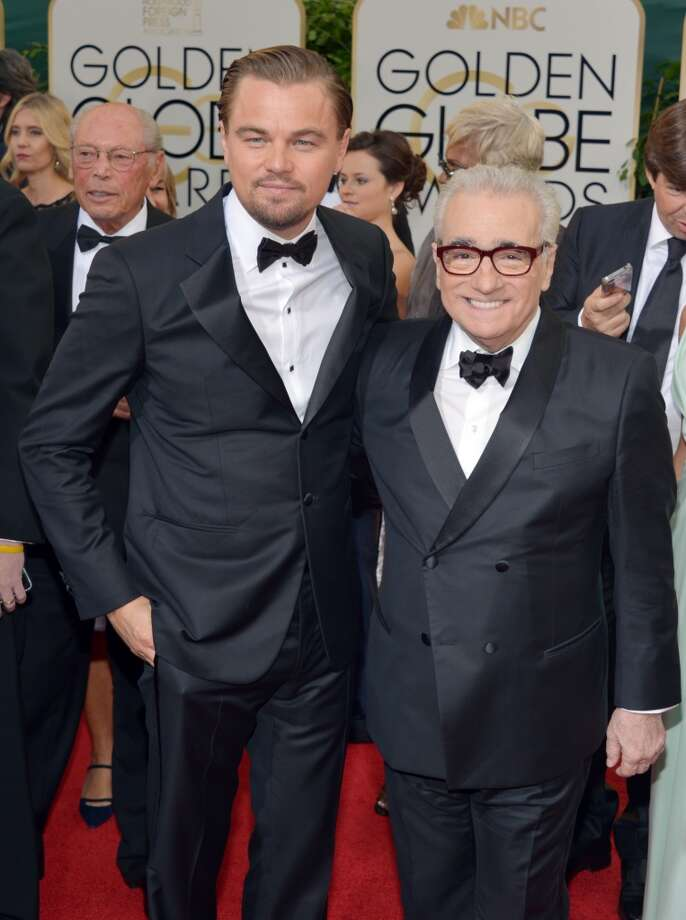 Leonardo DiCaprio, left, and Martin Scorsese arrive at the 71st annual Golden Globe Awards at the Beverly Hilton Hotel on Sunday, Jan. 12, 2014, in Beverly Hills, Calif. Photo: John Shearer, Associated Press
