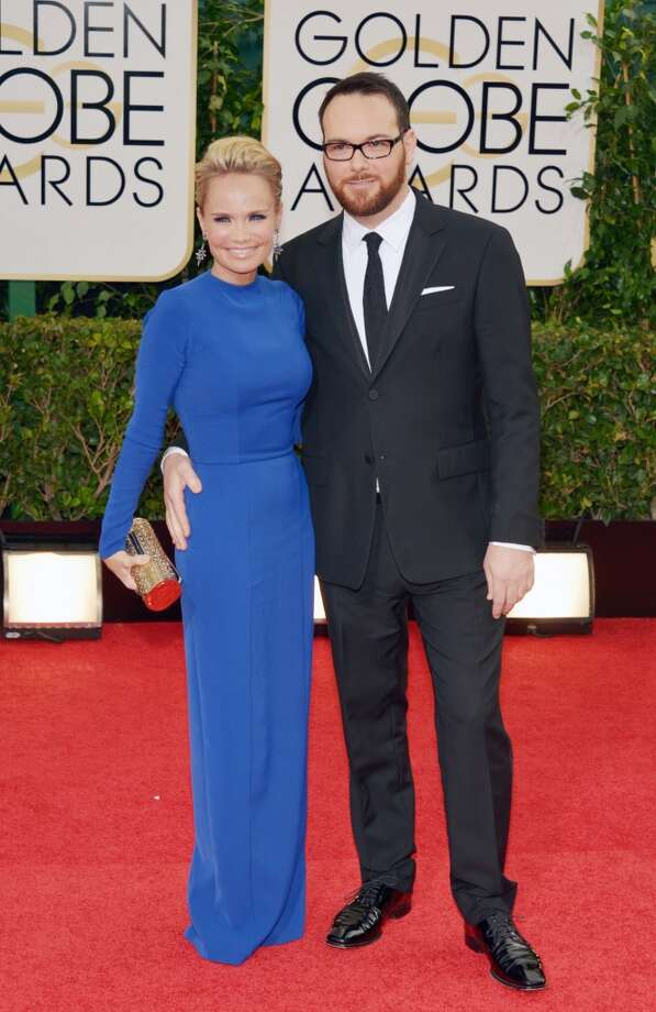 Kristin Chenoweth, left, and Dana Brunetti arrive at the 71st annual Golden Globe Awards at the Beverly Hilton Hotel on Sunday, Jan. 12, 2014, in Beverly Hills, Calif. Photo: John Shearer, Associated Press