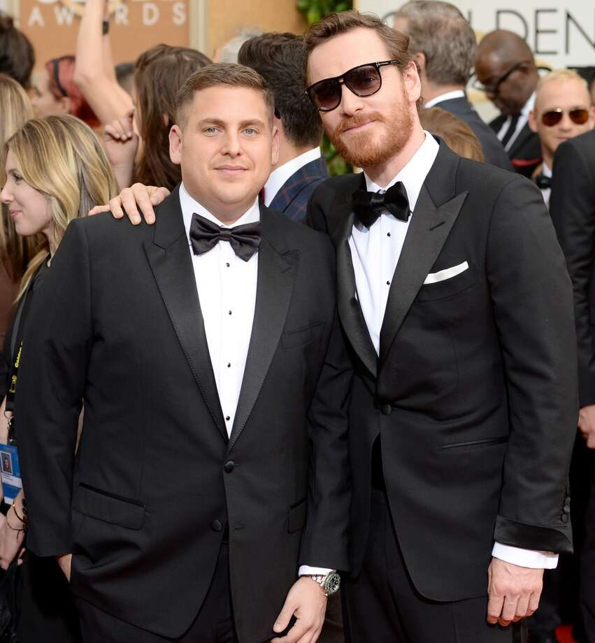 Actors Jonah Hill (L) and Michael Fassbender attend the 71st Annual Golden Globe Awards held at The Beverly Hilton Hotel on January 12, 2014 in Beverly Hills, California. Photo: Jason Merritt, Getty Images