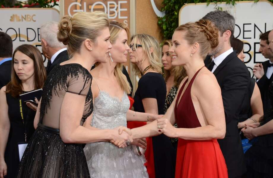 Actresses, from left, Lily Rabe, Sarah Paulson, and Amy Adams arrive at the 71st annual Golden Globe Awards at the Beverly Hilton Hotel on Sunday, Jan. 12, 2014, in Beverly Hills, Calif. Photo: Jordan Strauss, Associated Press