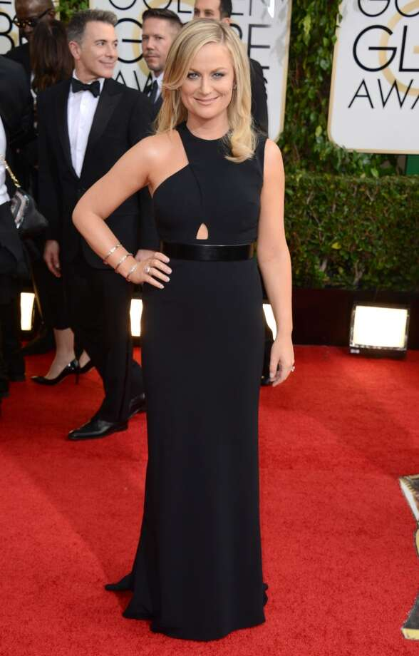 Amy Poehler arrives at the 71st annual Golden Globe Awards at the Beverly Hilton Hotel on Sunday, Jan. 12, 2014, in Beverly Hills, Calif. AP) Photo: Associated Press