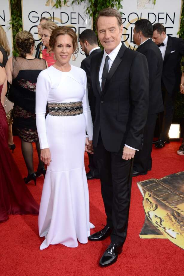 Robin Dearden, left, and Bryan Cranston arrive at the 71st annual Golden Globe Awards at the Beverly Hilton Hotel on Sunday, Jan. 12, 2014, in Beverly Hills, Calif. Photo: Jordan Strauss, Associated Press
