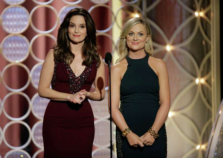 This image released by NBC shows hosts Tina Fey, left, and Amy Poehler during the 71st annual Golden Globe Awards at the Beverly Hilton Hotel on Sunday, Jan. 12, 2014, in Beverly Hills, Calif. (AP Photo/NBC, Paul Drinkwater) Photo: Paul Drinkwater, Associated Press / NBC