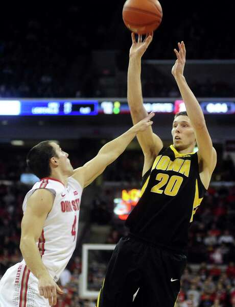 Iowa's Jarrod Uthoff, taking a jumper over Ohio State's Aaron Craft, finished the game with 10 points. Photo: Ryan Young / Getty Images / 2014 Getty Images