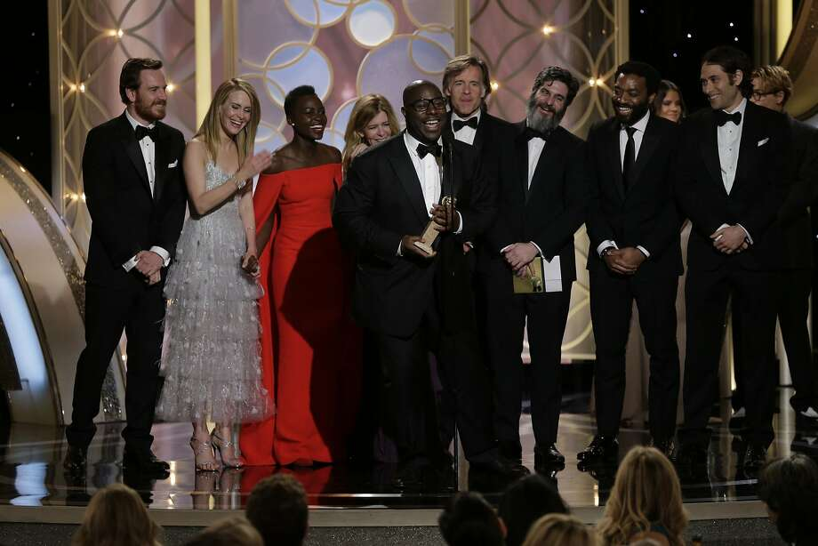 "Director Steve McQueen (center) and the cast of ""12 Years a Slave"" accept the Golden Globe Award for best dramatic picture. Photo: Handout, Getty Images"