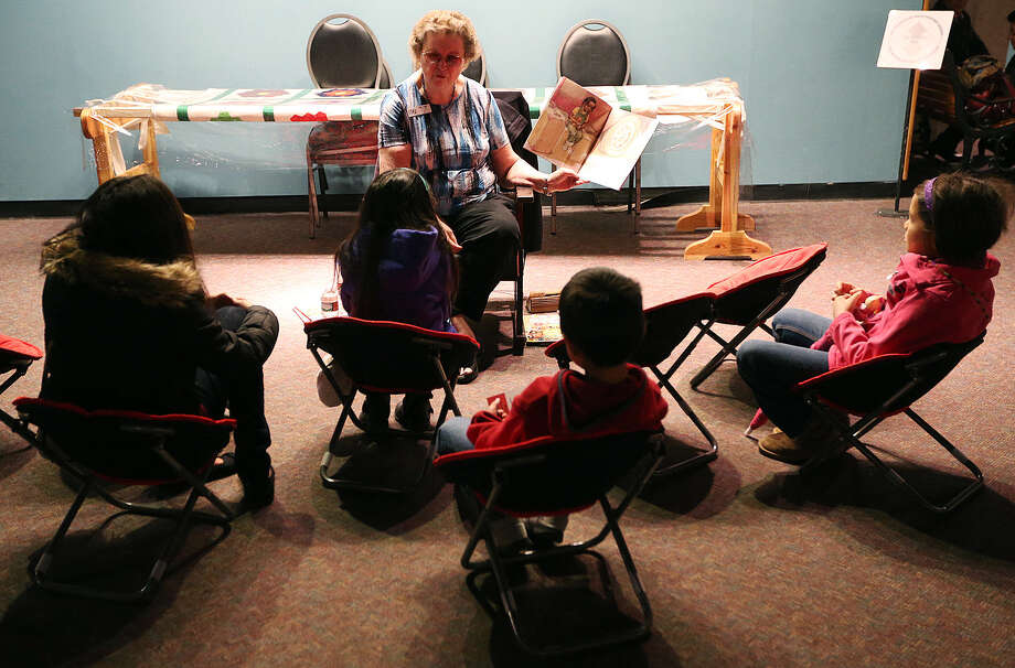 "Janet Drane reads to children at the exhibit titled ""The Struggle for Civil Rights in Texas"" at the Institute of Texan Cultures. Students from UTSA developed the exhibit based on research from a summer class taught by Scott Sherer. Photo: Photos By Jerry Lara / San Antonio Express-News / © 2014 San Antonio Express-News"
