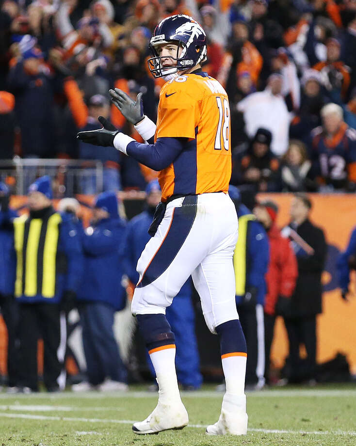 Peyton Manning applauds a late TD that led Denver to victory in a divisional playoff game. Photo: Christian Petersen / Getty Images / 2014 Getty Images