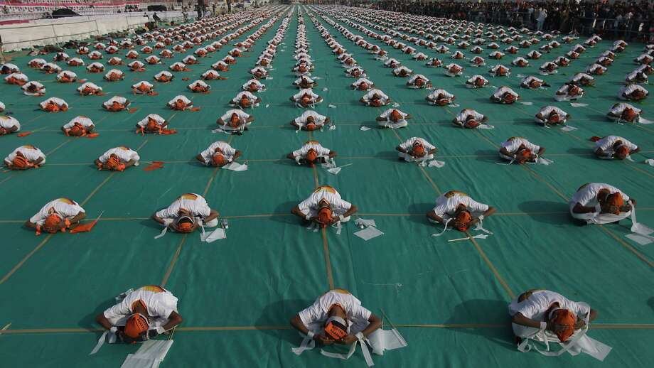 Pre-kite exercise: Scores of schoolchildren perform yoga as a three-day kite festival begins in Ahmadabad, India. Photo: Ajit Solanki, Associated Press