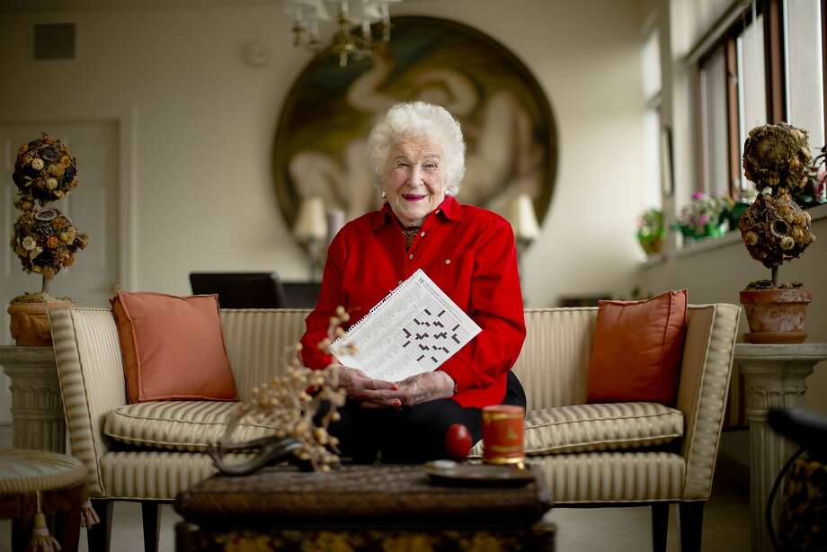 Longtime crossword constructor Bernice Gordon born on Jan. 11, 1914, poses for a portrait at her home, Tuesday, Dec. 31, 2013, in Philadelphia.  The New York Times is scheduled publish one of her puzzles, making her the first centenarian ever to have a grid printed in the paper. Gordon's feat comes not long after the centennial of the puzzle itself. (AP Photo/Matt Rourke) Photo: Matt Rourke, Associated Press