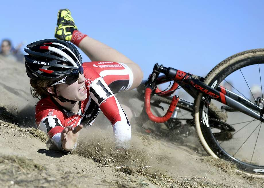 Emma White , of Team Cyclocrossworld, hits the dirt hard during the USA Cycling Cyclo-cross National Championship Elite Women's race on Sunday, Jan. 12, 2014, at the Valmont Bike Park in Boulder, Colo. (AP Photo/The Daily Camera, Jeremy Papasso) Photo: Jeremy Papasso, Associated Press