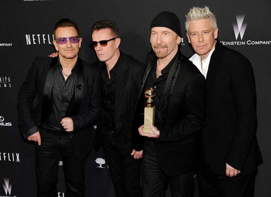 "Bono, from left, Larry Mullen, Jr., The Edge and Adam Clayton, of the Irish band U2, winners of the award for best original song for ""Ordinary Love"" from the film ""Mandela: Long Walk to Freedom,"" arrive at The Weinstein Company's Golden Globes after party at the Beverly Hilton Hotel on Sunday, Jan. 12, 2014, in Beverly Hills, Calif. (Photo by Chris Pizzello/Invision/AP) Photo: Chris Pizzello, Chris Pizzello/Invision/AP / Invision"