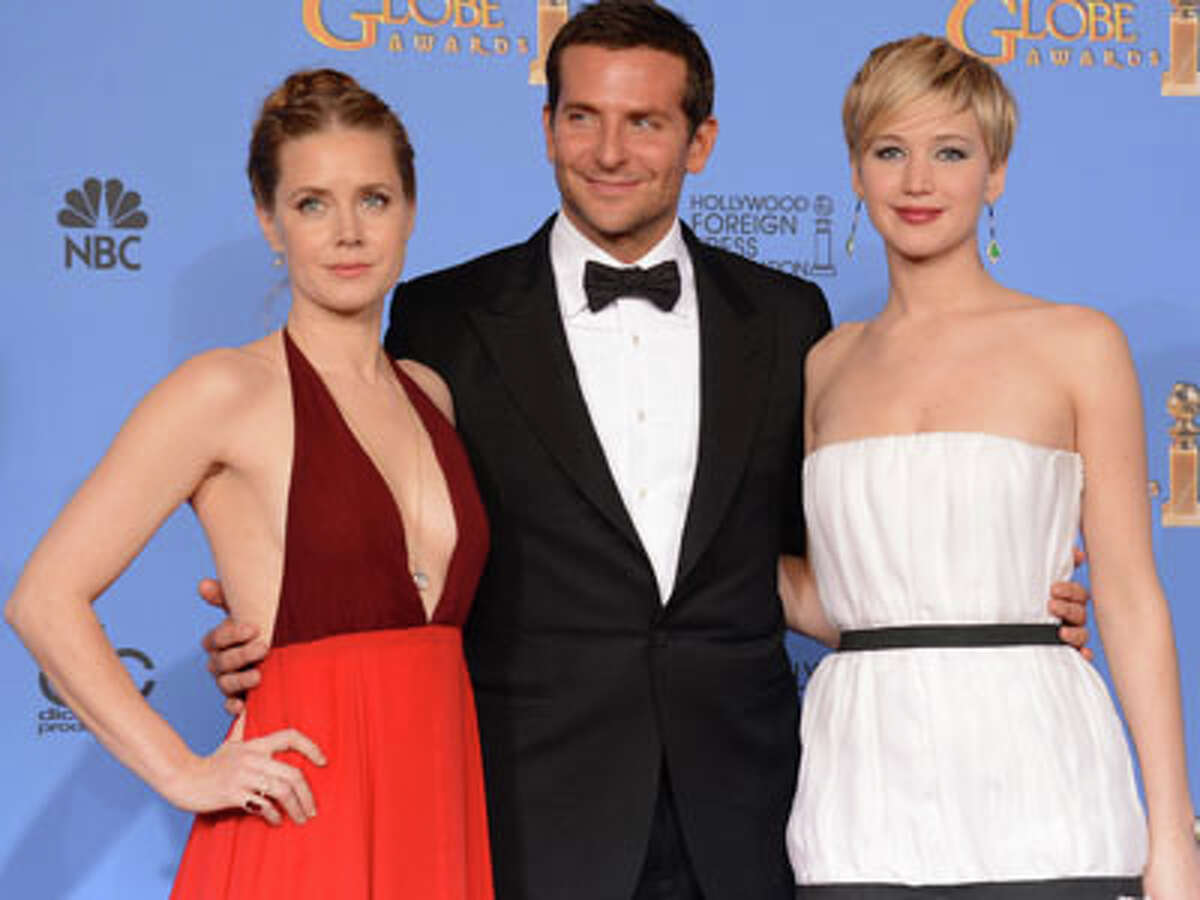 From left, Amy Adams, Bradley Cooper, and Jennifer Lawrence, winners of the award for best motion picture - comedy or musical for