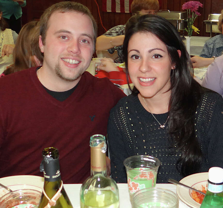 Peter DeMonte and Erica Tranquillo enjoy the Pasta Night fundraiser gathering at Greenfield Hill Grange on Saturday evening. Photo: Mike Lauterborn / Fairfield Citizen contributed