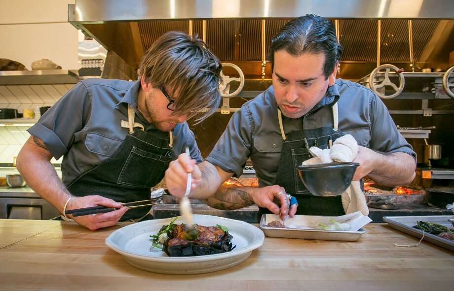 Chef  Mark Liberman and sous chef Alexander Phaneuf plate the pork cooked in tea leaves at TBD. Photo: John Storey, Special To The Chronicle