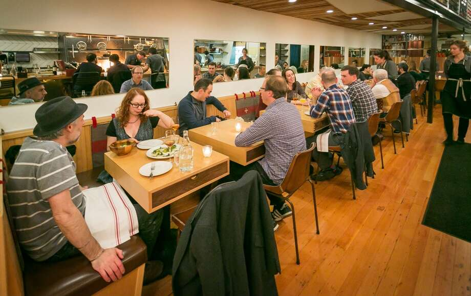 Diners enjoy dinner at TBD. Photo: John Storey, Special To The Chronicle